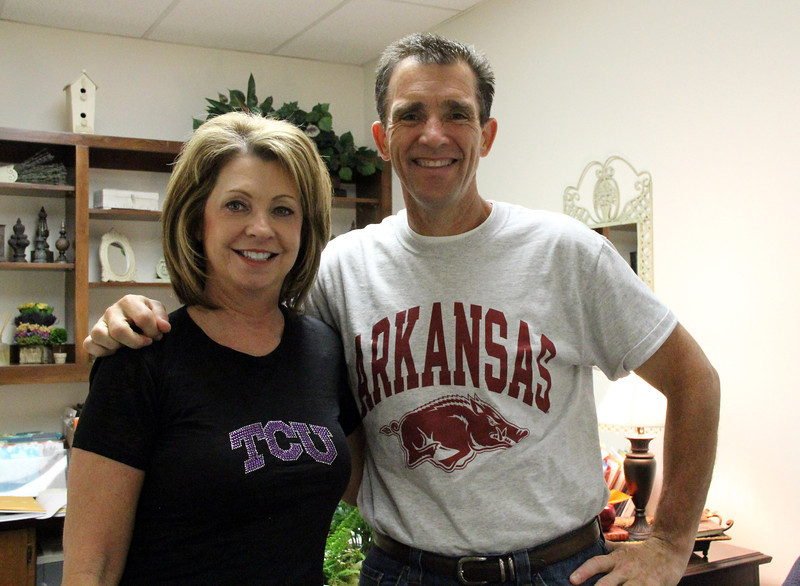 District officials wearing shirts from their colleges.