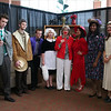 "Debbe Roesler posing with students dressed in costumes at ""Clue""-themed luncheon."