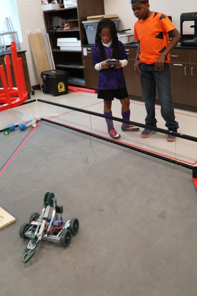 Students test-drive a robot.