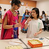 Students teach others how to hold chopsticks.
