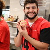 A Trinity athlete holds a cookie.