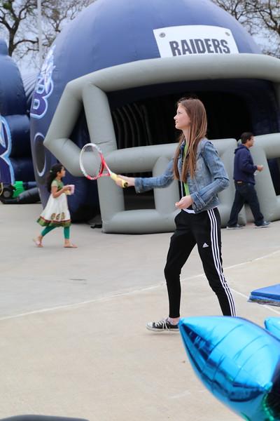 A girl plays tennis.