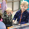 Children look at a constructed robot.