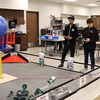 Robotics students show off their creations.