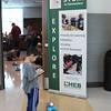 A boy controls a robot with an iPad.