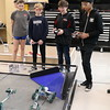 Robotics students test out their robots.