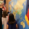 People place a sticker on the map labeling their country of birth.
