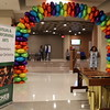 A balloon arch leading down a hallway.