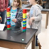 Students build with Legos and other supplies.