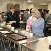 Culinary students make cookies.