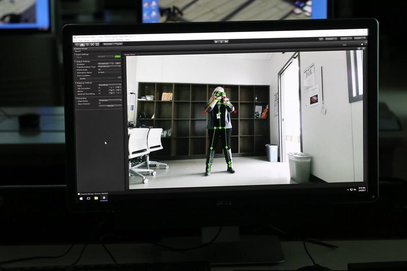 A student practices motion capture.
