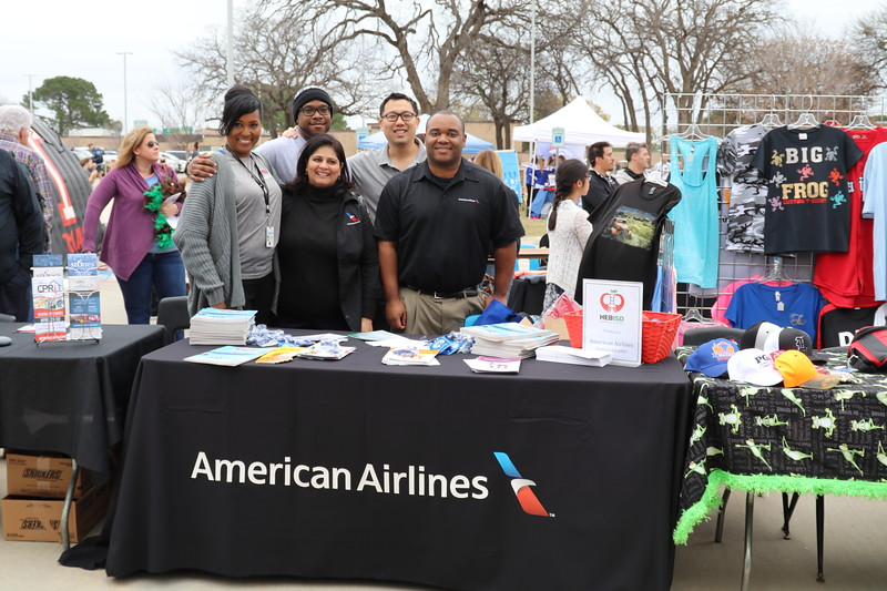 American Airlines associates work their table.