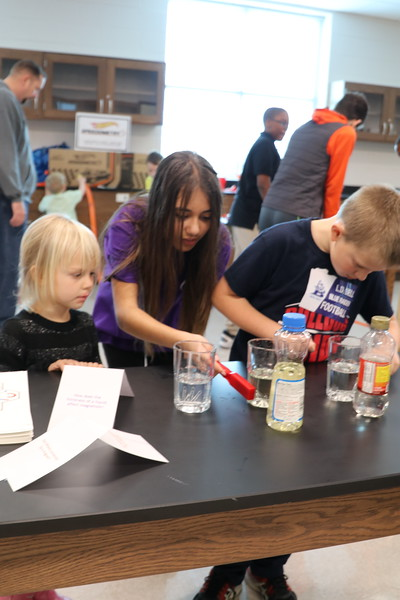 Students perform science experiments.