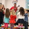 Children listen to a guitarist.