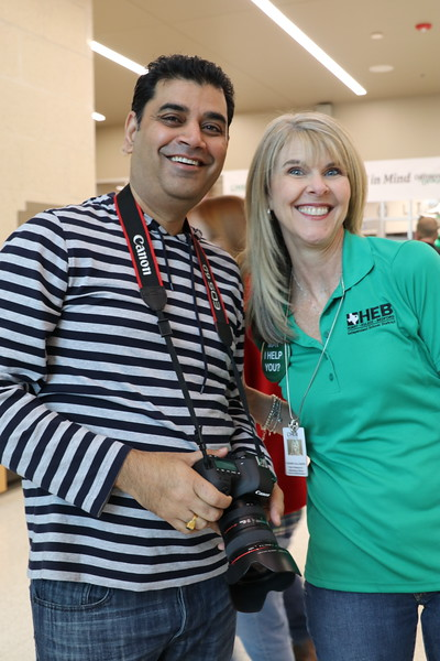 A photographer and a district official enjoy the showcase.