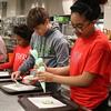 Students make cookies.