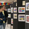 People admire artwork from various schools.
