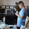 Students use a 3d printer.