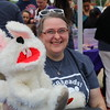 A volunteer with a rabbit puppet.
