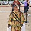 A boy poses in a firefighter photo op.