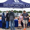 People pick up information from the city of Bedford table.
