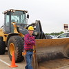 A character from a popular children's show poses with a construction vehicle.