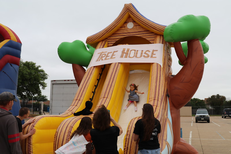 A girl goes down an inflatable slide.
