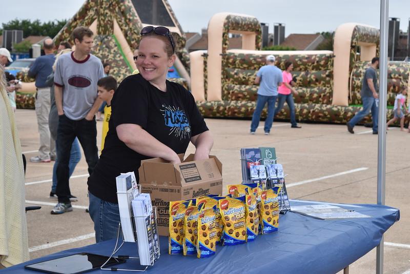 A volunteer displays candy.