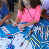 A student colors a bookmark.