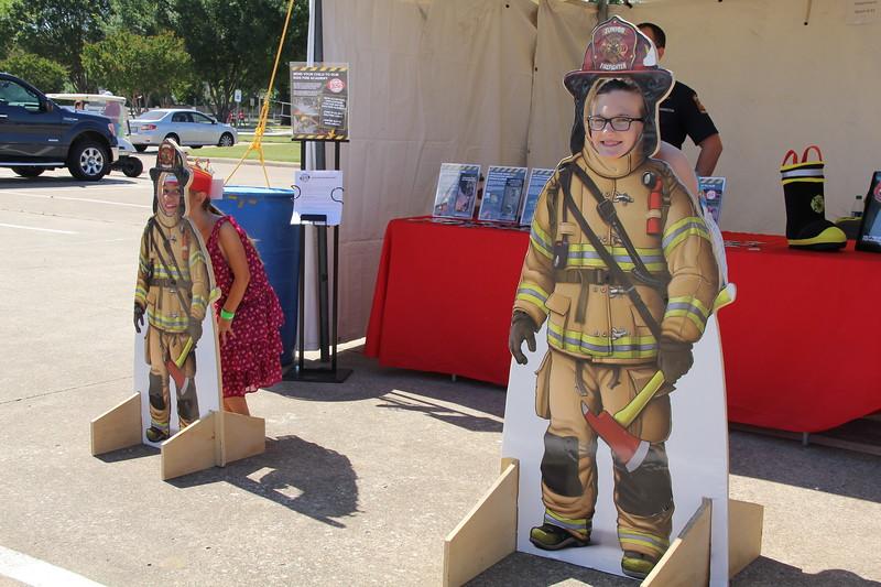 Children pose in a fireman photo op.