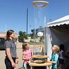 Children observe an exhibit.