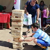 A student plays with a giant Jenga tower.