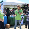A volunteer gets interviewed by the school district Public Relations team.