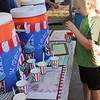 A child gets shaved ice from a food booth.