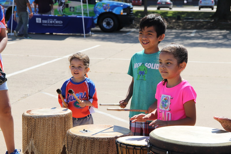Students play different types of drums.
