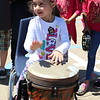 A girl plays a drum.