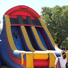 A boy goes down an inflatable slide.