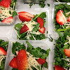 A healthy strawberry salad with parmesan cheese.