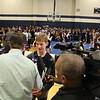 A news anchor interviews a student.