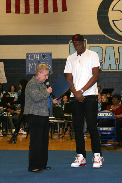 The mayor of Euless reads a statement as Myles Turner listens.