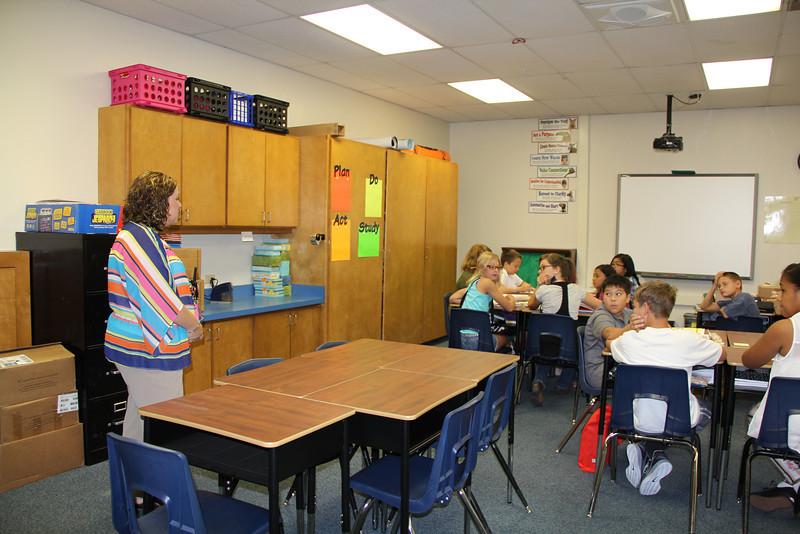 New principal talks to class.