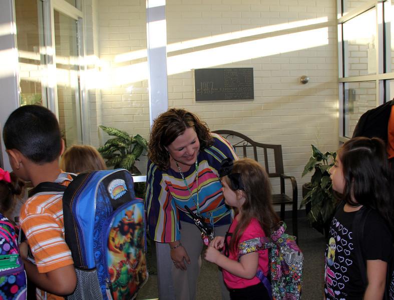New principal greeting students.