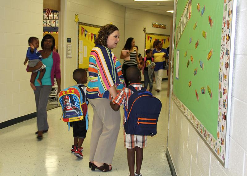New principal walks students to class.