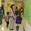 New principal walks students to class.