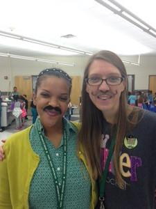 Teachers wearing their mustaches.