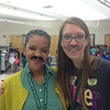 Teachers wearing their mustaches.