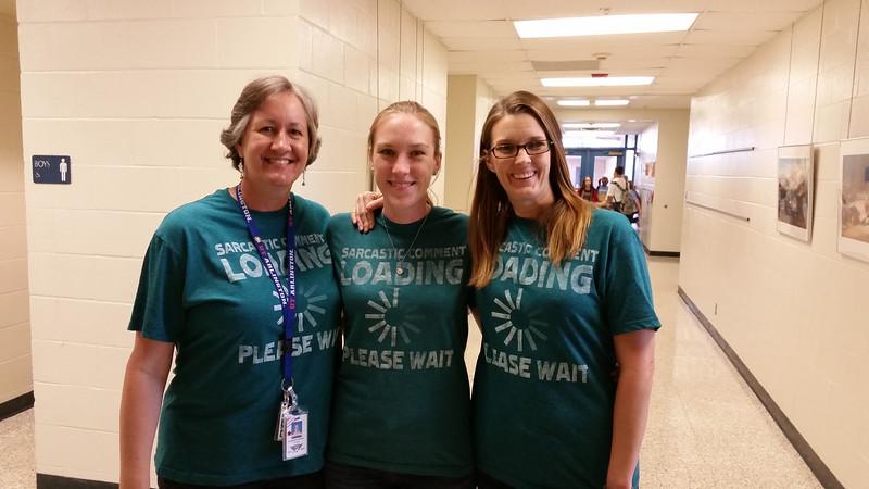 Teachers wearing their triplet shirts.