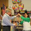 Superintendent gives teacher balloons.