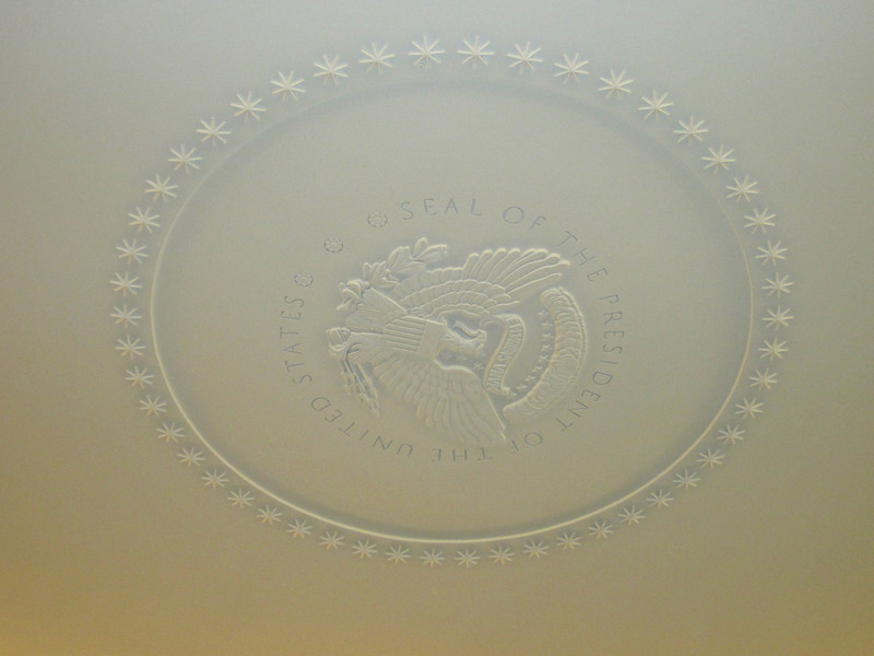 The Presidential Seal on the ceiling.