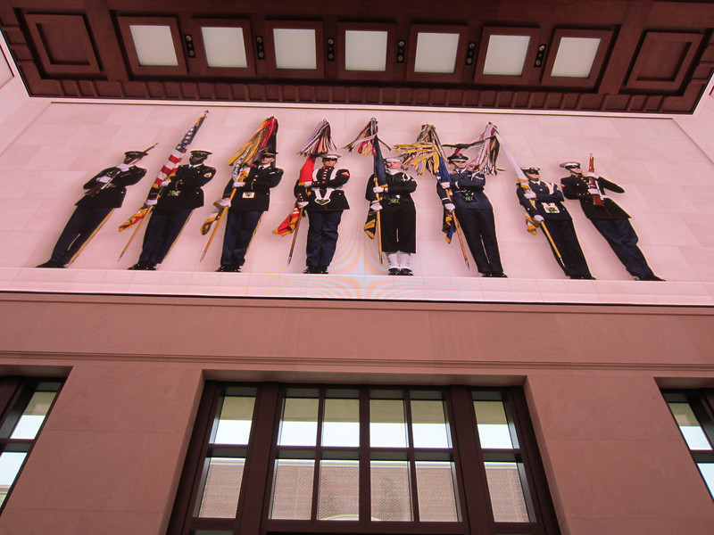 A mural depicts members of the national color guard.